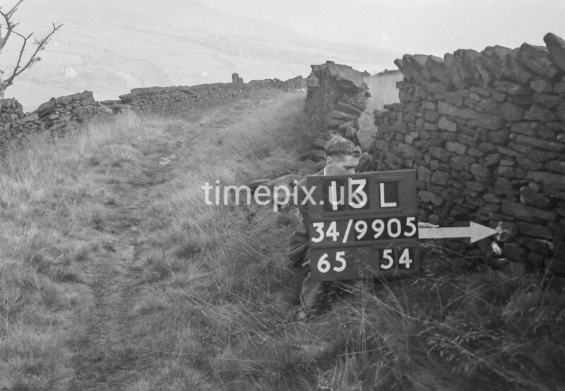 SD990513L, Man marking Ordnance Survey minor control revision point with an arrow in 1950s