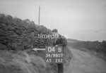 SD980704B, Man marking Ordnance Survey minor control revision point with an arrow in 1950s