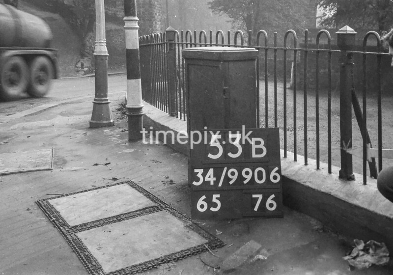 SD990653B, Man marking Ordnance Survey minor control revision point with an arrow in 1950s