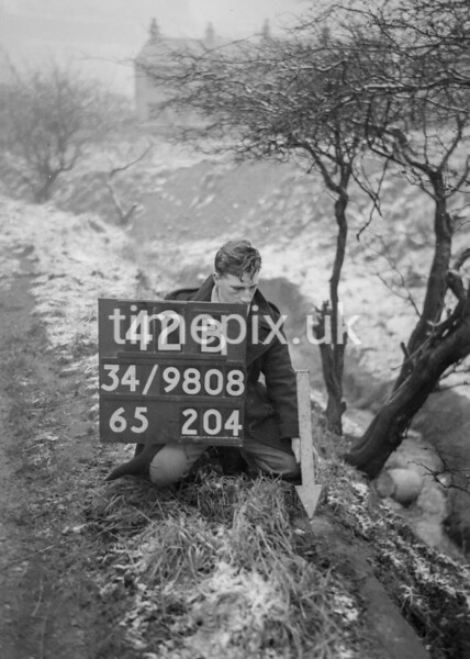 SD980842B, Man marking Ordnance Survey minor control revision point with an arrow in 1950s