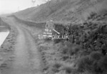 SD990698A, Man marking Ordnance Survey minor control revision point with an arrow in 1950s