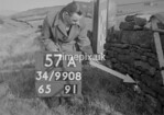 SD990857A, Man marking Ordnance Survey minor control revision point with an arrow in 1950s