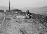 SD980656A, Man marking Ordnance Survey minor control revision point with an arrow in 1950s