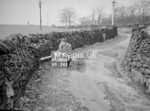 SD980647K, Man marking Ordnance Survey minor control revision point with an arrow in 1950s