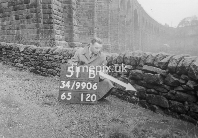 SD990651B1, Man marking Ordnance Survey minor control revision point with an arrow in 1950s