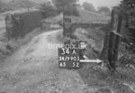 SD990534A, Man marking Ordnance Survey minor control revision point with an arrow in 1950s