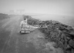 SD980933A, Man marking Ordnance Survey minor control revision point with an arrow in 1950s