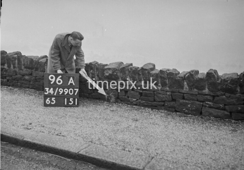 SD990796A, Man marking Ordnance Survey minor control revision point with an arrow in 1950s