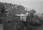 SD990641C, Man marking Ordnance Survey minor control revision point with an arrow in 1950s