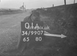 SD990701A, Man marking Ordnance Survey minor control revision point with an arrow in 1950s