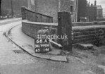SD990666A2, Man marking Ordnance Survey minor control revision point with an arrow in 1950s