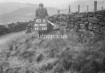 SD990760B1, Man marking Ordnance Survey minor control revision point with an arrow in 1950s