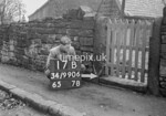 SD990617B, Man marking Ordnance Survey minor control revision point with an arrow in 1950s