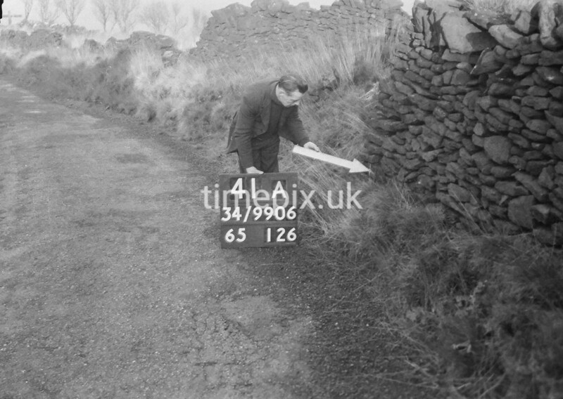 SD990641A, Man marking Ordnance Survey minor control revision point with an arrow in 1950s