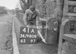 SD980841A, Man marking Ordnance Survey minor control revision point with an arrow in 1950s