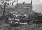 SD980813B, Man marking Ordnance Survey minor control revision point with an arrow in 1950s