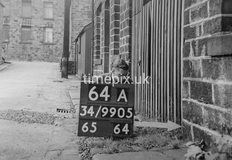 SD990564A, Man marking Ordnance Survey minor control revision point with an arrow in 1950s