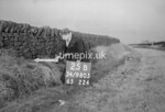 SD980525B1, Man marking Ordnance Survey minor control revision point with an arrow in 1950s