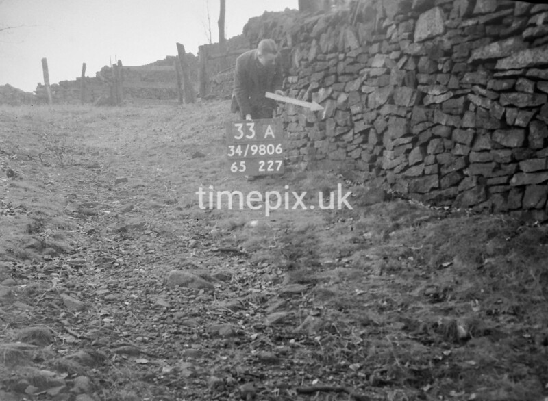 SD980633A, Man marking Ordnance Survey minor control revision point with an arrow in 1950s