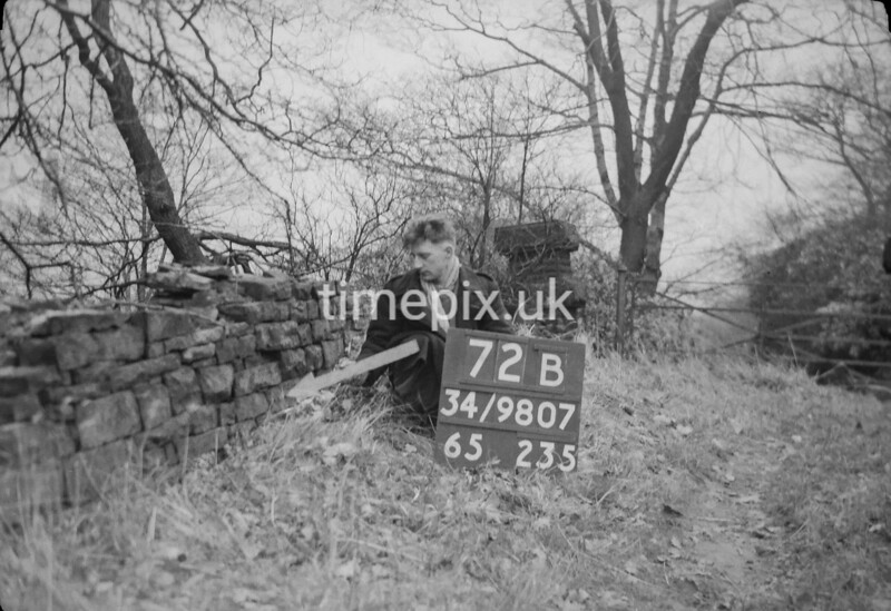 SD980772B, Man marking Ordnance Survey minor control revision point with an arrow in 1950s