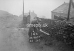 SD980714K, Man marking Ordnance Survey minor control revision point with an arrow in 1950s