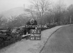 SD980772S, Man marking Ordnance Survey minor control revision point with an arrow in 1950s