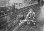 SD990643B, Man marking Ordnance Survey minor control revision point with an arrow in 1950s