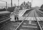 SD990663L1, Man marking Ordnance Survey minor control revision point with an arrow in 1950s