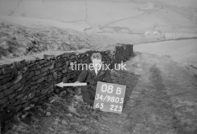 SD980508B, Man marking Ordnance Survey minor control revision point with an arrow in 1950s