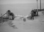 SD980628A, Man marking Ordnance Survey minor control revision point with an arrow in 1950s
