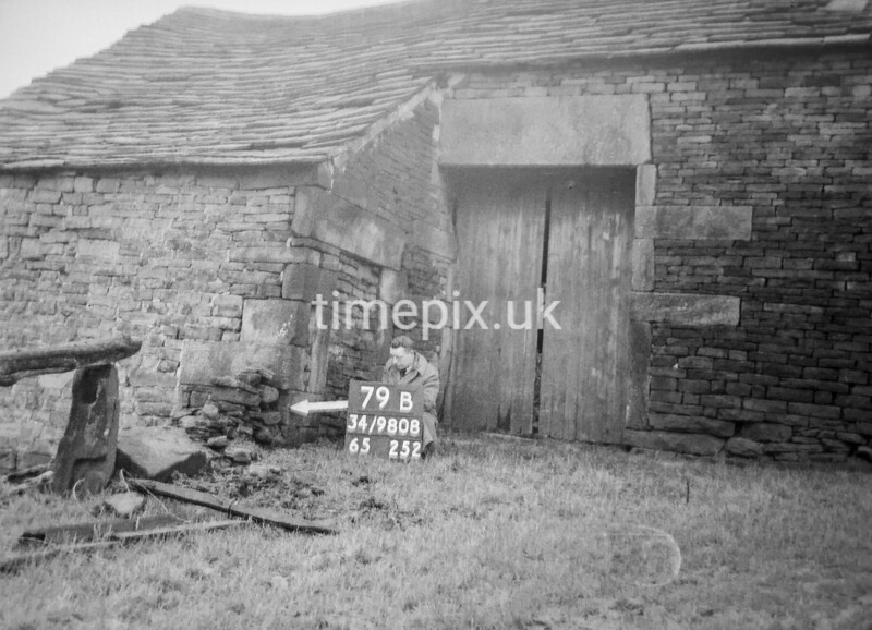 SD980879B, Man marking Ordnance Survey minor control revision point with an arrow in 1950s