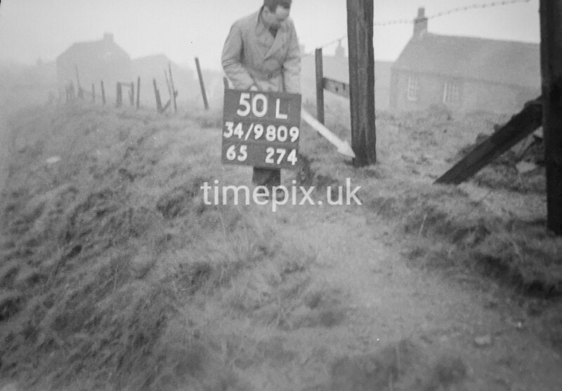 SD980950L, Man marking Ordnance Survey minor control revision point with an arrow in 1950s