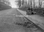 SD980783B, Man marking Ordnance Survey minor control revision point with an arrow in 1950s