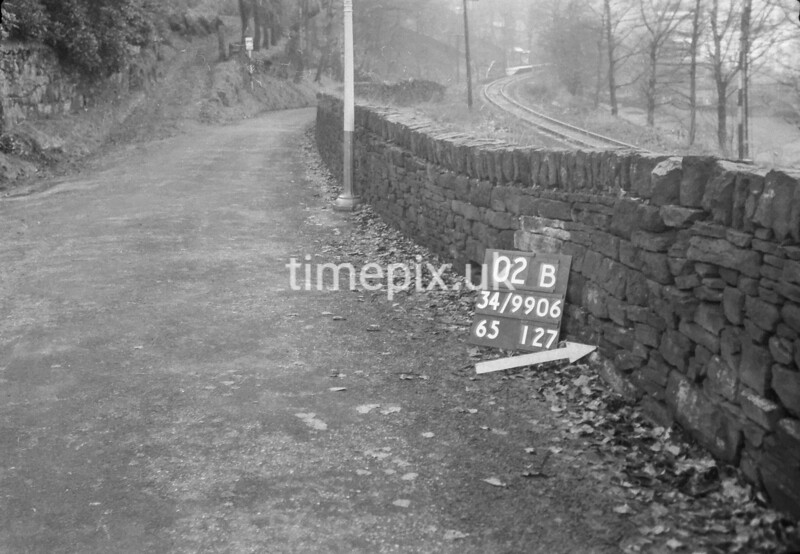 SD990602B1, Man marking Ordnance Survey minor control revision point with an arrow in 1950s