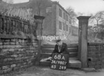 SD980768A, Man marking Ordnance Survey minor control revision point with an arrow in 1950s