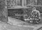 SD990670A2, Man marking Ordnance Survey minor control revision point with an arrow in 1950s