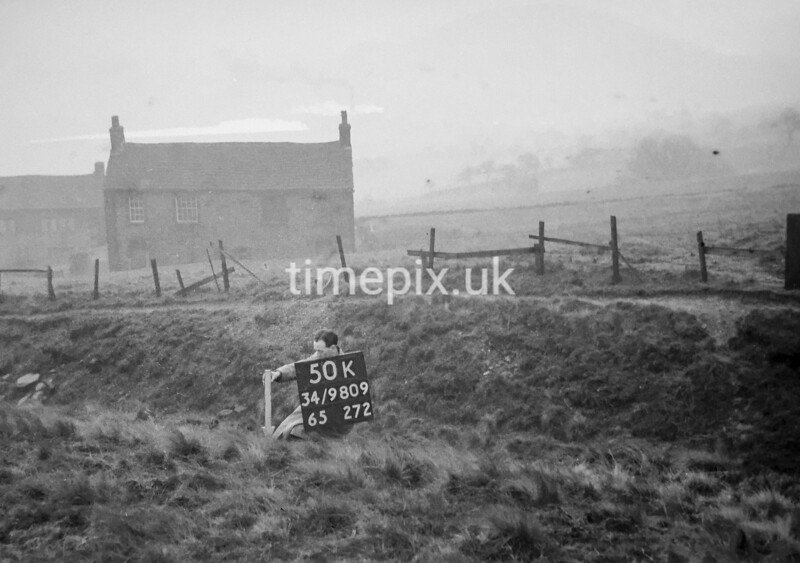 SD980950K, Man marking Ordnance Survey minor control revision point with an arrow in 1950s