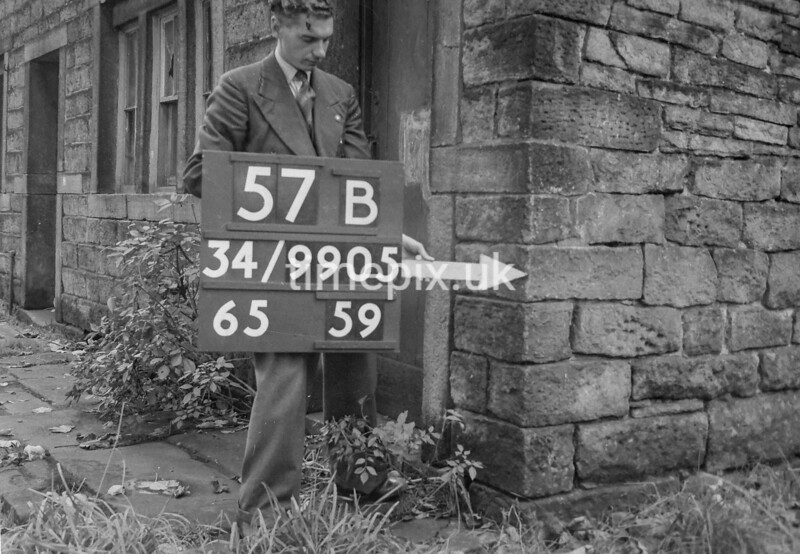 SD990557B, Man marking Ordnance Survey minor control revision point with an arrow in 1950s