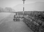 SD980802B, Man marking Ordnance Survey minor control revision point with an arrow in 1950s