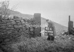 SD990640A2, Man marking Ordnance Survey minor control revision point with an arrow in 1950s