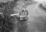 SD990532B, Man marking Ordnance Survey minor control revision point with an arrow in 1950s