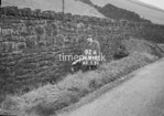SD990792A, Man marking Ordnance Survey minor control revision point with an arrow in 1950s