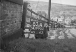 SD990583B, Man marking Ordnance Survey minor control revision point with an arrow in 1950s