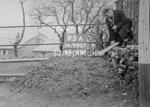 SD990795A2, Man marking Ordnance Survey minor control revision point with an arrow in 1950s