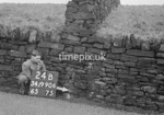 SD990624B, Man marking Ordnance Survey minor control revision point with an arrow in 1950s