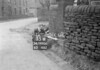 SD990635W2, Man marking Ordnance Survey minor control revision point with an arrow in 1950s