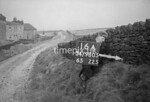 SD980516A, Man marking Ordnance Survey minor control revision point with an arrow in 1950s