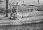 SD990791L, Man marking Ordnance Survey minor control revision point with an arrow in 1950s