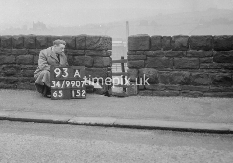 SD990793A2, Man marking Ordnance Survey minor control revision point with an arrow in 1950s