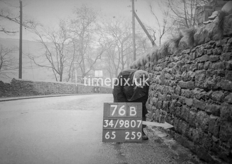 SD980776B, Man marking Ordnance Survey minor control revision point with an arrow in 1950s